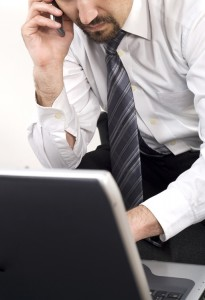 businessman on phone and laptop